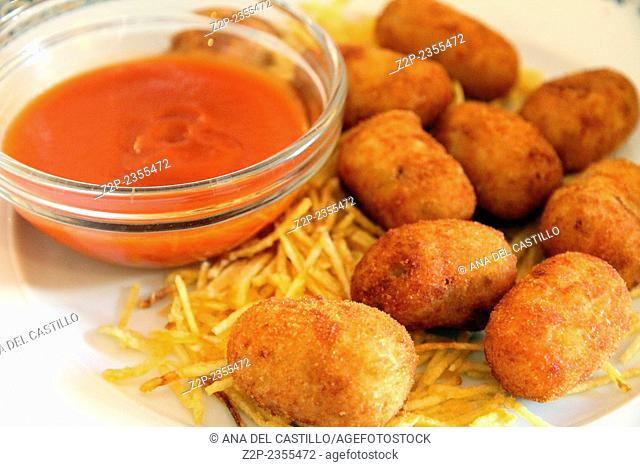 Ham croquettes , tomato sauce and chip potatoes