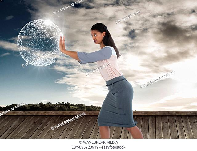 Businesswoman pushing glowing orb sphere