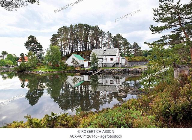 Traditional homestead on the edge of an inlet at the Sunnmore open-air museum on the outskirts of Alesund, Norway