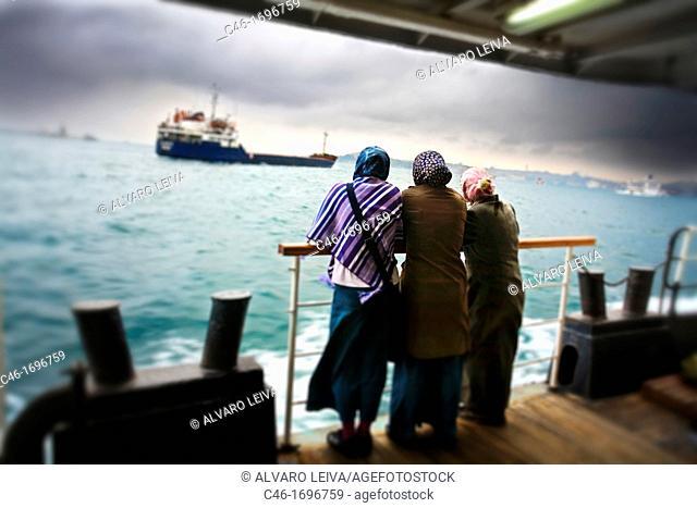 Commuters on Bosphorus ferry  Istanbul  Turkey