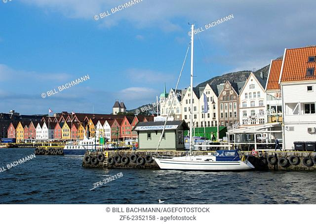 Bergen Norway Bryggen old town with famous wooden leaning houses and water at harbor pier at landmarks for tourists in BRYGGEN area scenic color