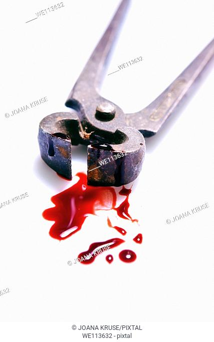 rusty pliers with blood