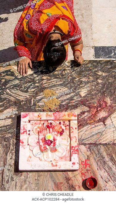 Worshipping marble sculpture of the Feet of Lord Vishnu, Jagdish Temple, Udaipur, Rajastan, India