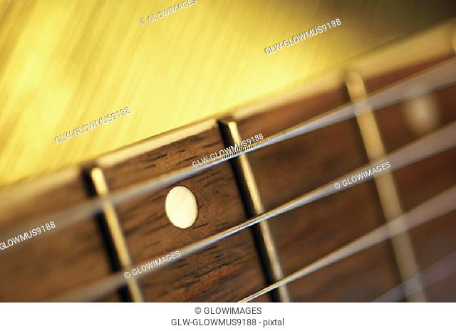 Close-up of handle and strings of electric guitar