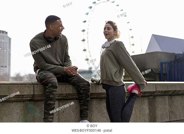 UK, London, two runners talking at riverwalk