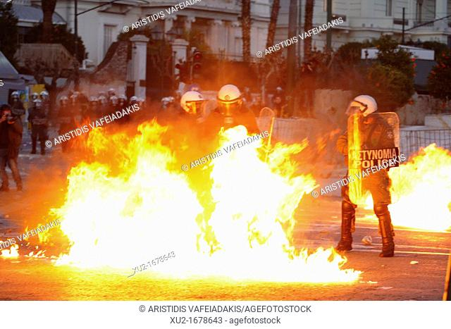 Protesters and riot police fought tunning battles in the center of Athens, as Greek lawmakers debuted legislation that would introduce severe austerity measures...