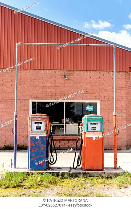 Vintage and closed fuel pump at closed petrol station, USA