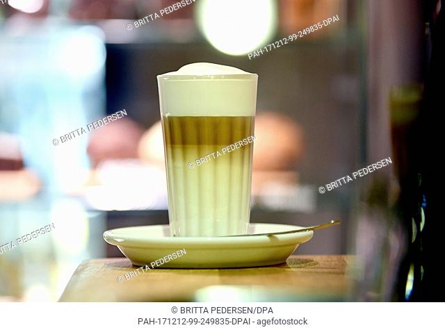 ATTENTION: EMBARGOED FOR PUBLICATION UNTIL 12 DECEMBER 17:00 GMT! - ILLUSTRATION - A saucer with a glas of Latte macchiato stands on a table in Berlin, Germany