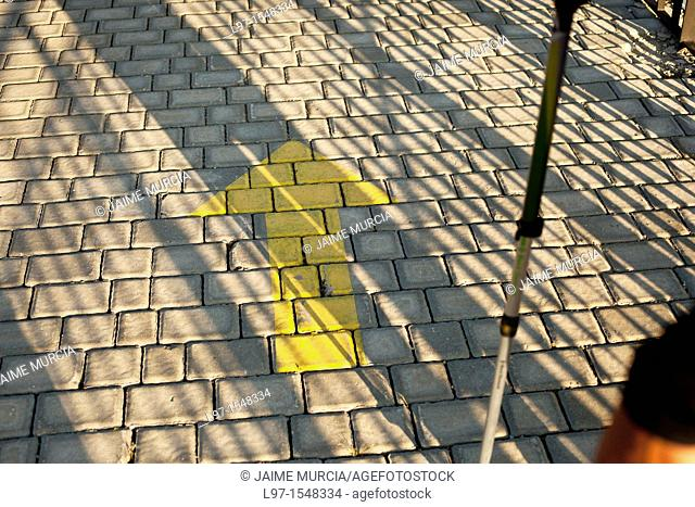 Yellow arrow marker pointing the way on the Camino de Santiago