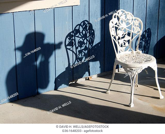 Wrought iron cafe chair on the sidewalk in Paso Robles  California, United states