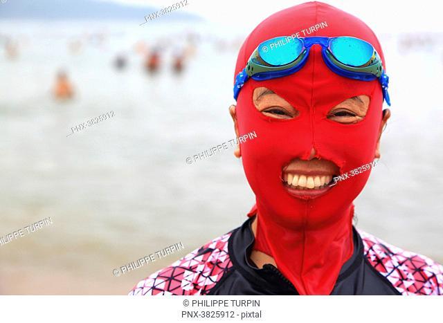 Asia, China, Shandong Province, Qingdao. Huiquan Bay, Beach Number 1. Facekini