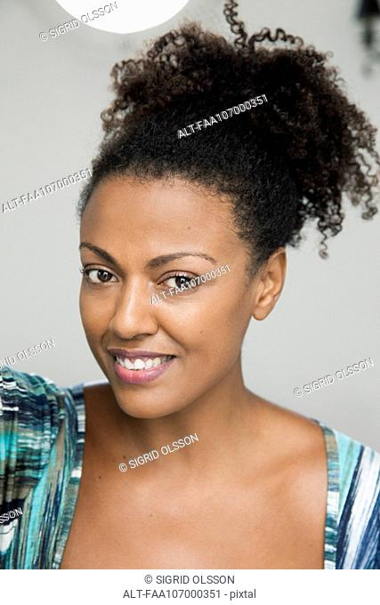 Woman smiling cheerfully, portrait