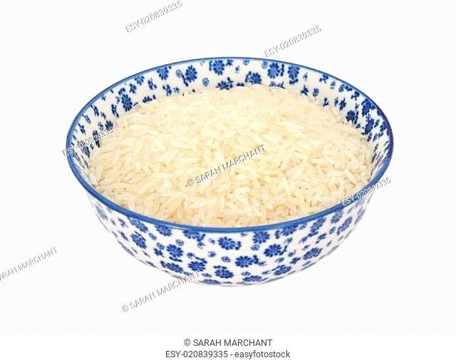 White long grain rice in a blue and white china bowl