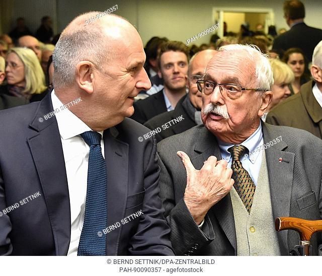 Brandenburg Premier Dietmar Woidke speaks with Roger Bordage (R), President of the International Sachsenhausen Committee