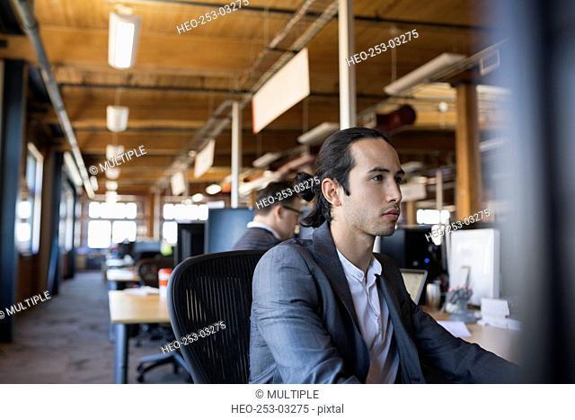 Focused businessman working in office
