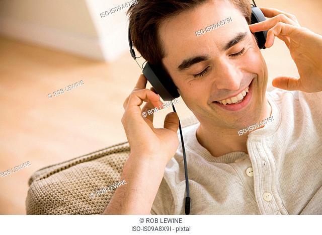 Mid adult man wearing headphones