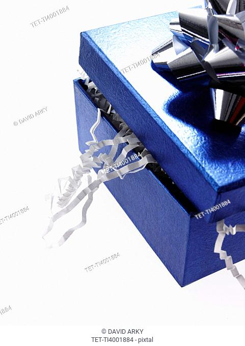 Studio shot of Blue Ribbon and Blue Box on white background
