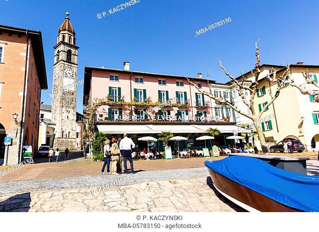 View from the waterside promenade on church and restaurants, Lago Maggiore, Ascona, Ticino, Switzerland, Alps