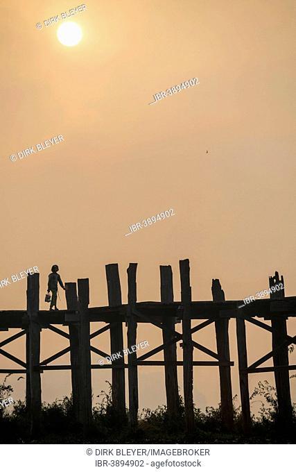 Locals on a teak bridge, U Bein Bridge over Taungthaman Lake at sunrise, Amarapura, Mandalay Division, Myanmar