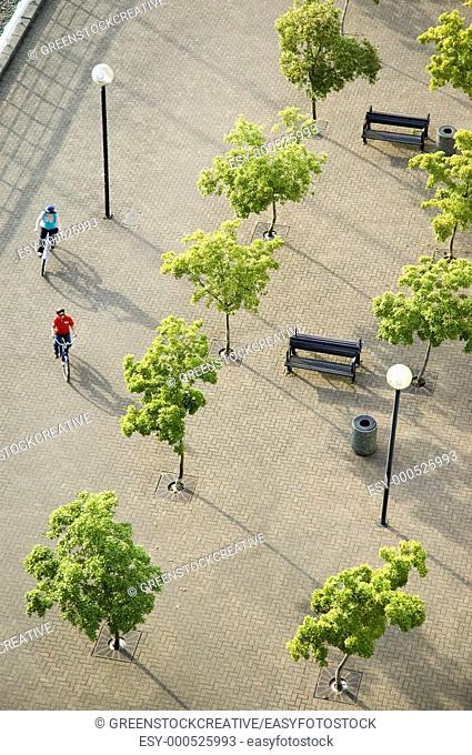 overhead view of a couple cycling through a plaza  Vancouver, British Columbia, Canada