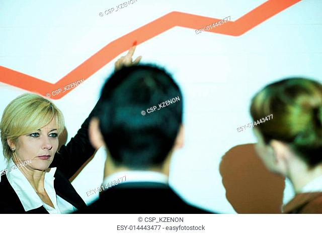 Business Team discussing graph
