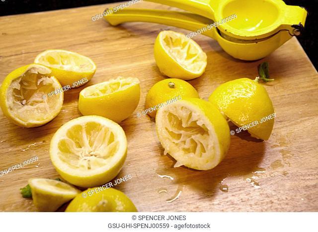 Fresh Squeezed Lemons on Cutting Board