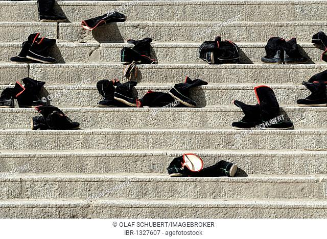 Black Tibetan monk boots on the stairs in front of the Assembly Hall, Tibetan Dukhang, the Labrang Monastery, Xiahe, Gansu, China, Asia