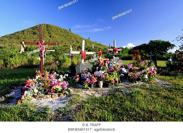graveyard with decorated graves, New Caledonia, Ile des Pins
