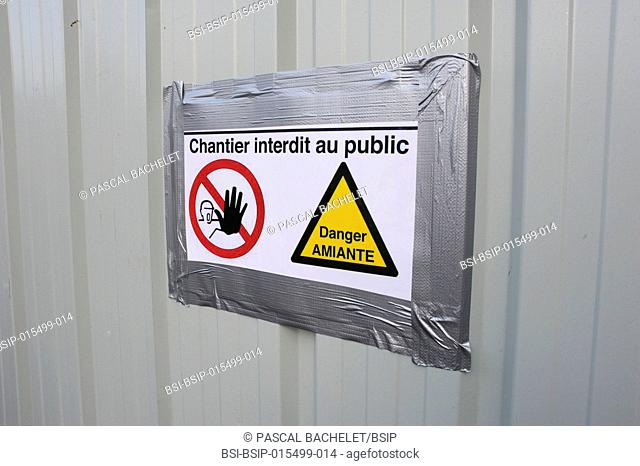 Asbestos removal site in the north of France. Sign forbidding entry to the general public