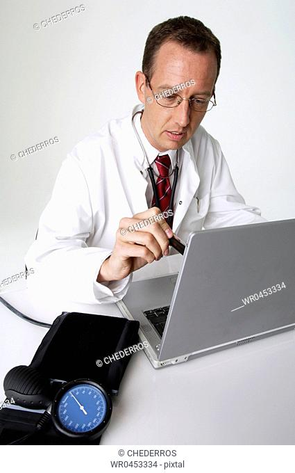 Close-up of a male doctor using a laptop