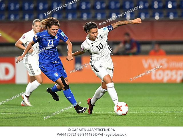 Germany's Dzsenifer Marozsan in action against Italy's Cristiana Girelli (L) during the women's European Soccer Championships group B match between Germany and...