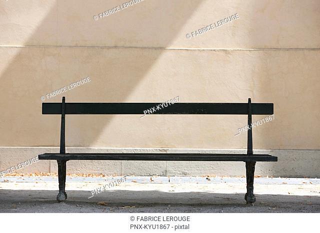 Empty bench in a garden, Terrasse De l'Orangerie, Jardin des Tuileries, Paris, Ile-de-France, France