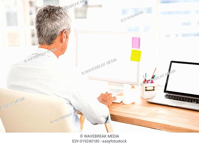 Casual businessman working with computer
