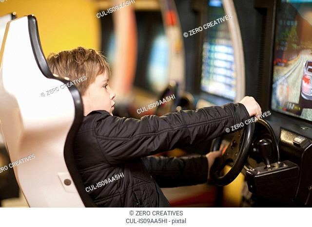 Boy playing on driving video game