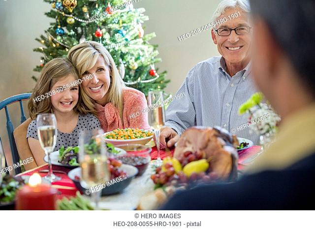 Family enjoying Christmas dinner together