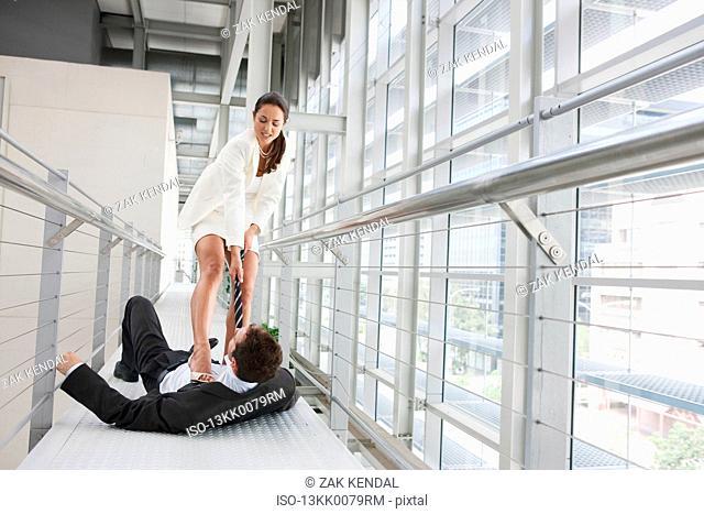 Business couple fighting in corridor