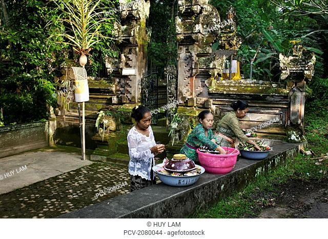 Women preparing offerings for the Kuningan Festival; Bali, Indonesia