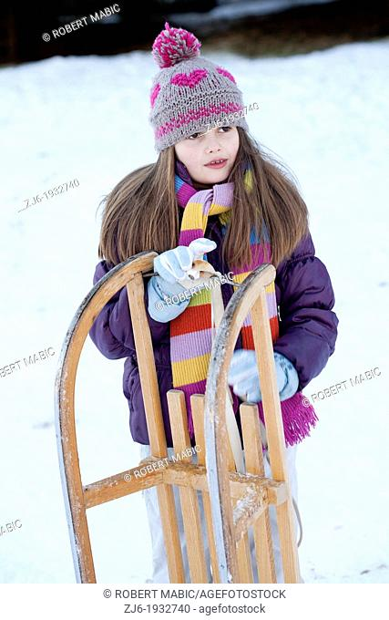 Girl with sleds