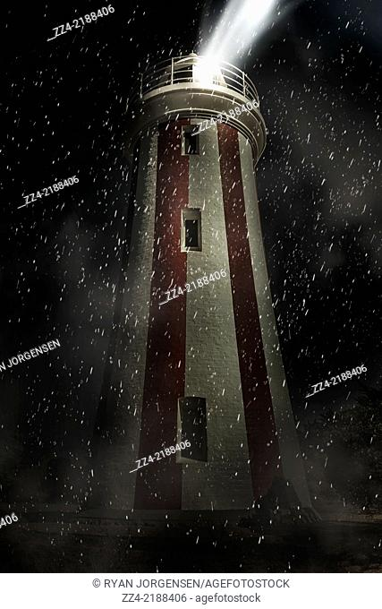 Creative fine artwork of the Mersey Bluff Lighthouse in Devonport during a dark night storm in Tasmania, Australia