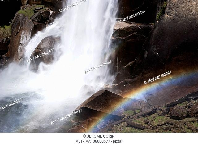 Rainbow at the base of a waterfall in Yosemite National Park, California, USA