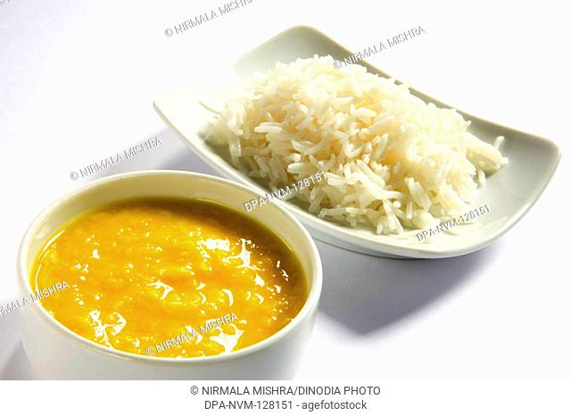 Vegetarian , Indian cuisine dal bhath boil basmati rice bhath chaval oryza sativa and moong dal mung beans phaseolus aureus served in bowls