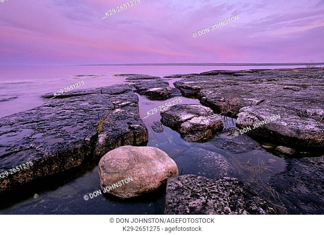 Dawn skies and shoreline limestones at Mississagi Point, Mississagi Lighthouse, Manitoulin Island, Ontario, Canada