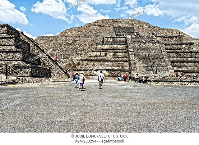 Teotihuacan, The Ruins of a 2400 year old City near Mexico City, Mexico. The Piramide de la Luna (Pyramid of the Moon) shown with tourists walking to, from