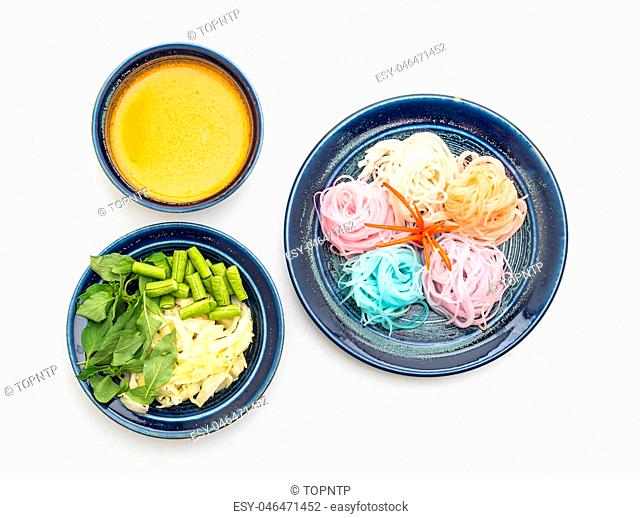 noodles with fish curry sauce and vegetable isolated on white background