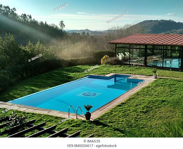 Swimming pool on 'Hostería de Torazo' resort, Tozao village, Cabranes municipality, Asturias, Spain