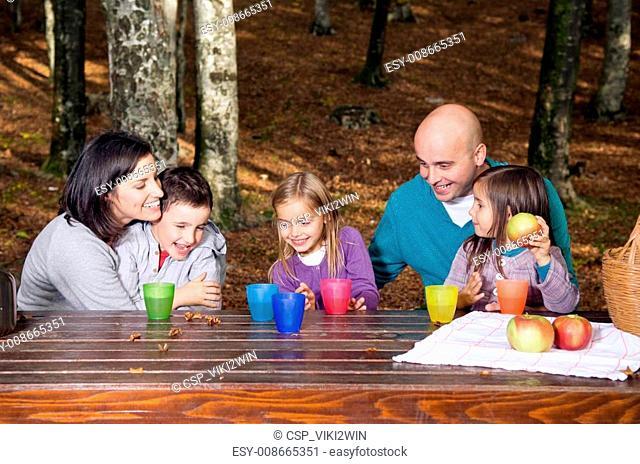 Happy family having fun outside