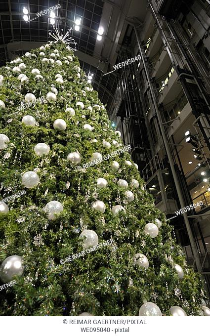 Silver balls on an oversized Christmas tree at the Eaton Centre shopping mall elevators in Toronto