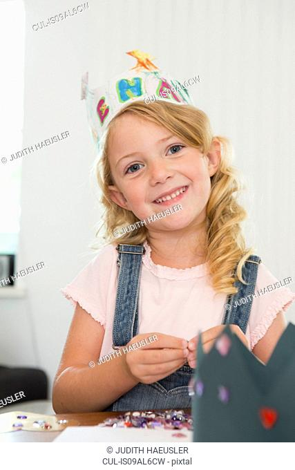 Girl making paper crown