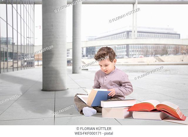 Germany, Brandenburg, Boy reading books