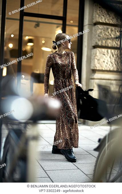 fashionable woman in city, in Munich, Germany
